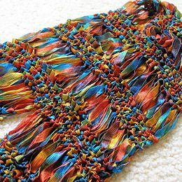 Free knitting pattern for Drop Stitch Ribbon scarf. Simple pattern made…