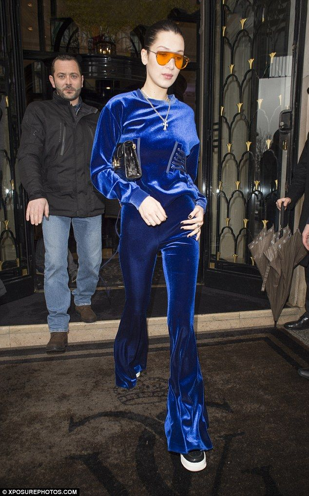 Bella Hadid, 20, kept the eye-catching outfits coming when she stepped out in a blue velvet tracksuit on Monday.