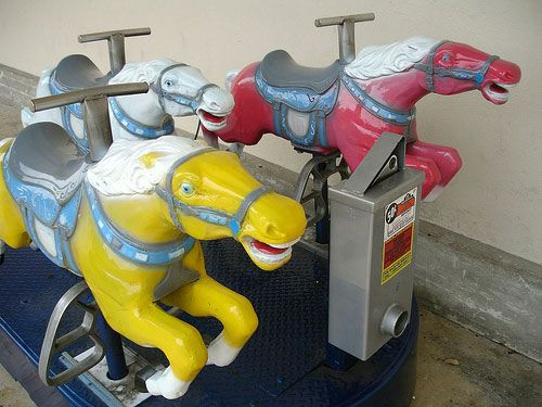 Coin operated race horse ride in front of Kmart.