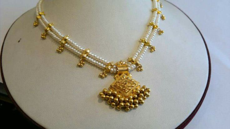 Two Layered Pearl Necklace with Gold Pendant www.addiga.com