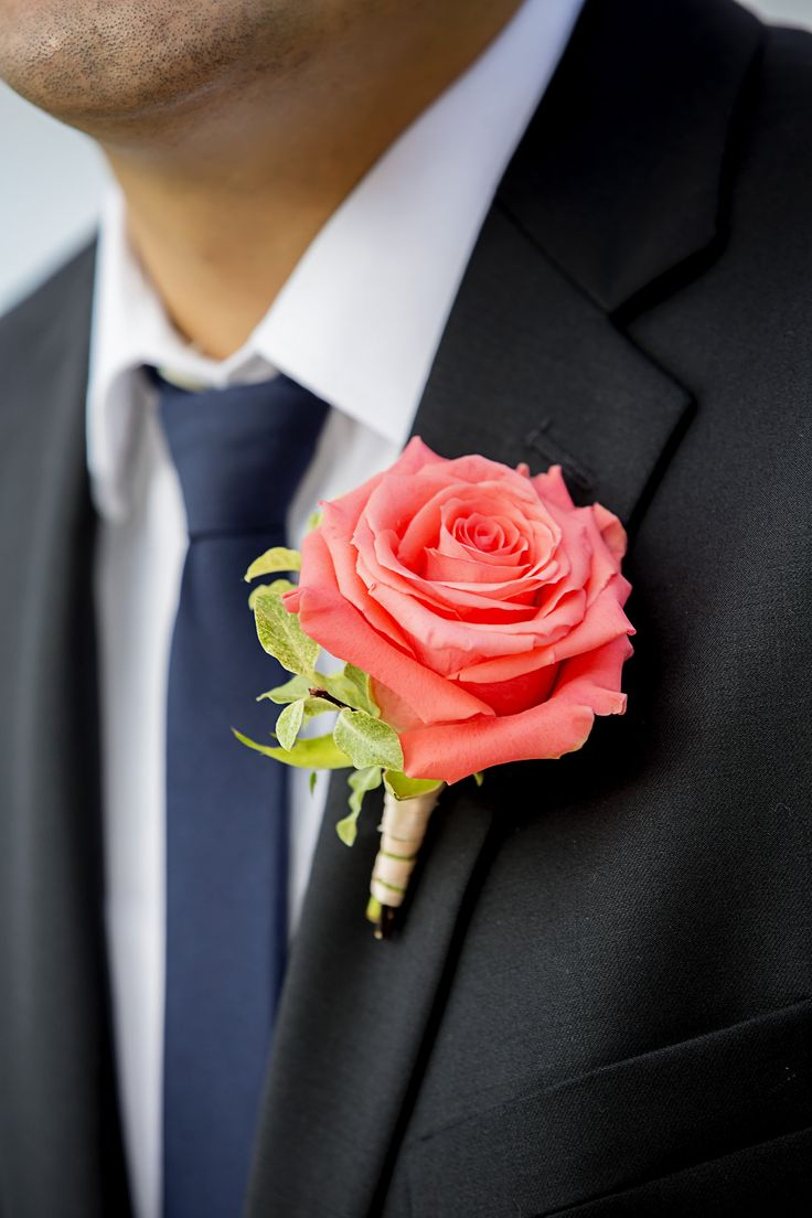 A bright coral colored rose for the groom's boutonniere | Meurer Image Photography