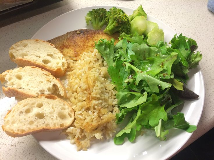 Tilapia pan fried, brown rice and green salad.