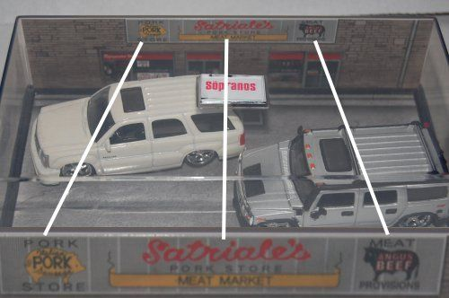 Sopranos Hummer H2 & Cadillac Escalade 2 Car In Per Mounted at Satriales Curbside street Scene by Jada Toy Inc. $14.99. Makes a Great adult Collectible for that Sopranos Fan Or Movie car Collector. 2 Car Pack set Christopher's Hummer H2 And Tony's Escalade. Original Sopranos Movie Die Cast Collectors set. Per mounted in Display Case With Satiales Curbside Scene. Both Mdoels Have been Tricked Out Rims, Tires, Paint Job. Sopranos - Hummer H2 and Cadillac Escalade. 1:64 scale diecas...