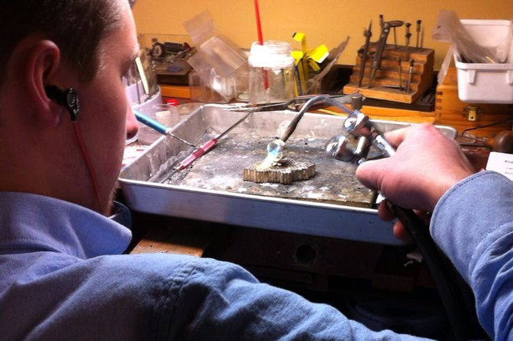 At the bench soldering a flower ring in sterling. This will be set with a vibrant pink tourmaline.