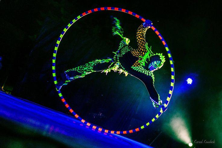 Acrobat with UV LED light Cyr Wheel in Black Light Show Anta Agni http://antaagni.com/uv-light-show/