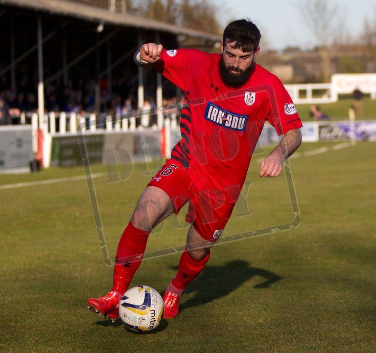 Queen's centre half Bryan Wharton in an attacking move