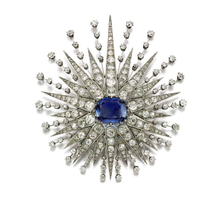 Late 19c brooch, sunburst mounted en tremblant. Cushion-shaped sapphire, with cushion shaped, rose and circular cut diamonds. Brooch fitting detachable. Image Sotheby's.