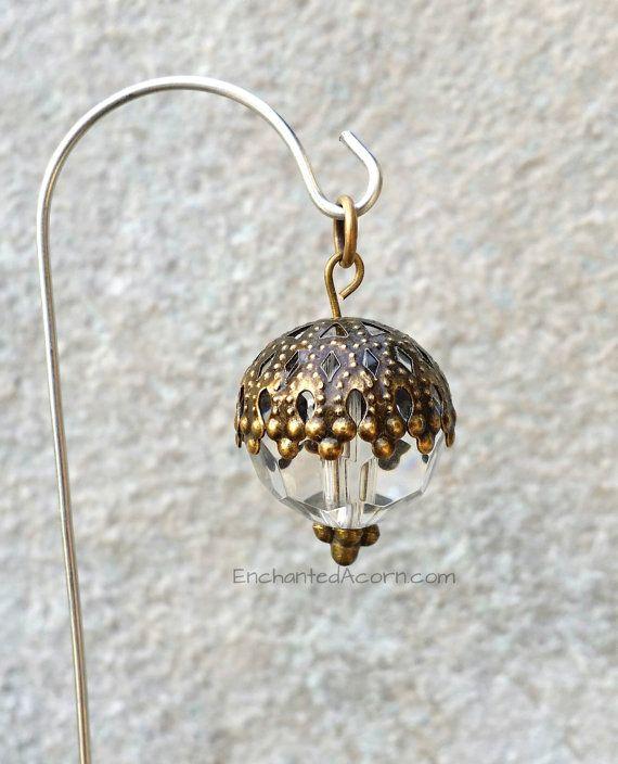 This sparkly little fairy garden lantern is a great way to add some dazzle to your miniature garden, fairy garden, terrarium or dollhouse.