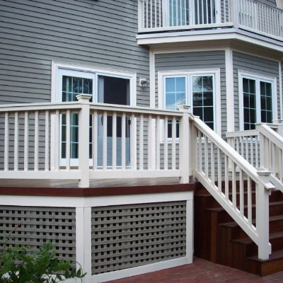 This mahogany deck and under deck skirting take inspiration in design and color from the existing home.