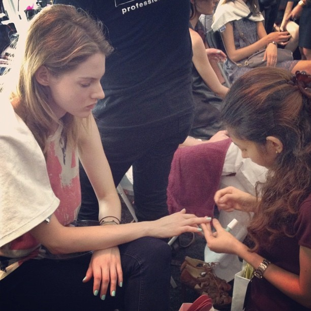 The WSJ's Robin Kawakami is backstage at the #RebeccaMinkoff show. She spotted a model getting a manicure in Essie's Mint Candy Apple. #nyfw.