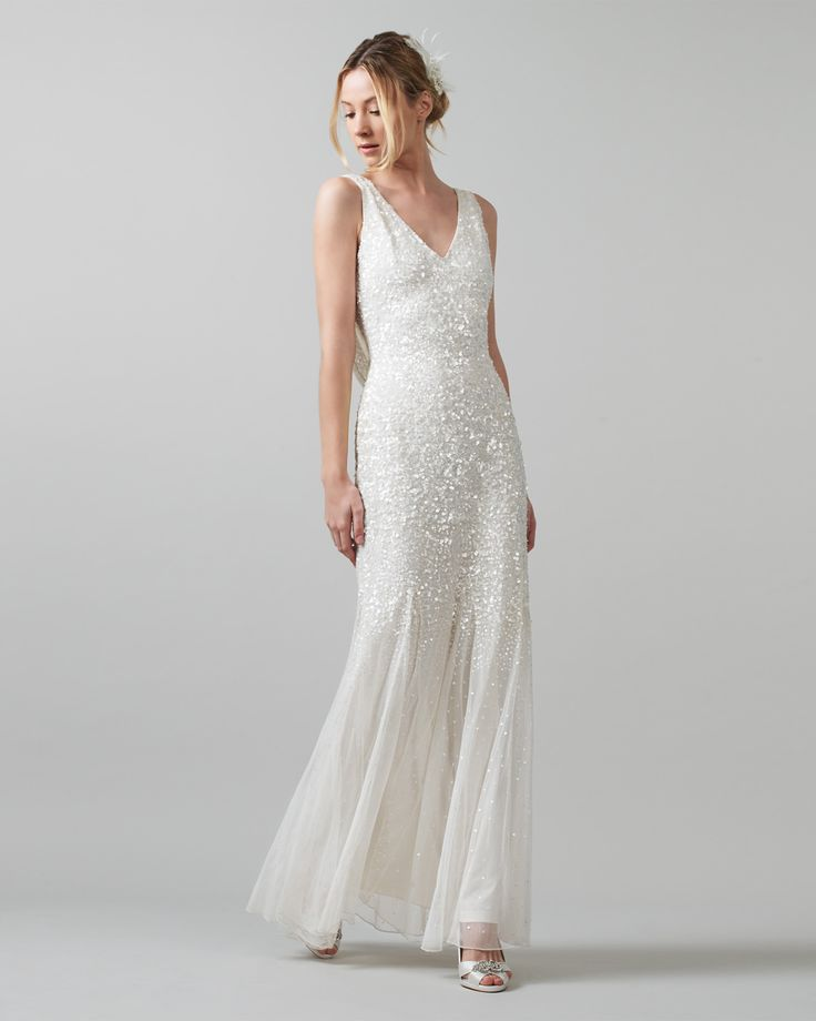 A Truly Stunning Wedding Dress Featuring Elaborate Sequin Detailing Throughout This Beautiful Features