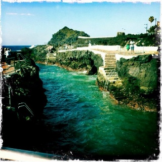 Garachico,Tenerife. Pools with stairs and slides between the rocks, protected from the surf. Awesome.