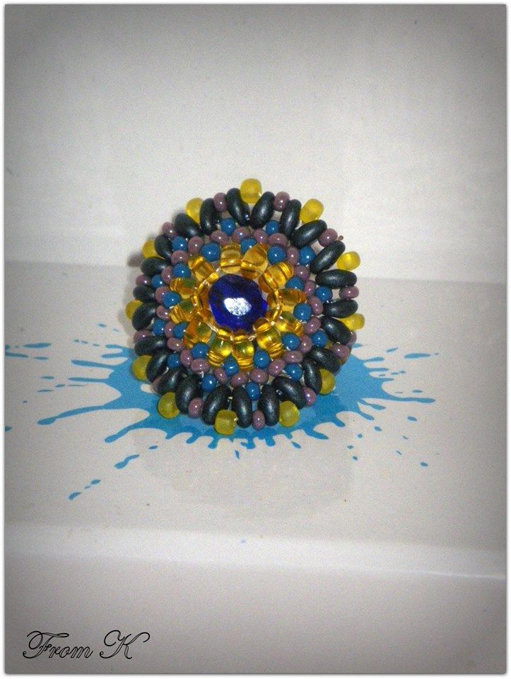 """Fairly popular circle design #ring in Boho look. This ring looks wonderful with a casual dress or with jeans. The combination of colors will match a lot of different clothes for different acosions. Czech seed beads and special """"twin"""" beads are used here. (""""twin"""" bead is the latest trend in beaded jewelry). (for details see this items in my albums https://www.facebook.com/BeadsFromK/photos) Ring - 15.00 Ron cod Rr 64 Available on order and in other colors."""