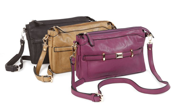 On-The-Go Purse - This stylish purse features an outer zippered pocket, and a top zippered closure that opens to three large inner sections. The centre section has a snap closure that keeps everything enclosed and can open wide to allow easy access to all those things you need to have with you. The look is completed with a cross-body shoulder strap that can be removed when you want to use this versatile purse as an evening bag. Find out more at www.EverydayStyle.com