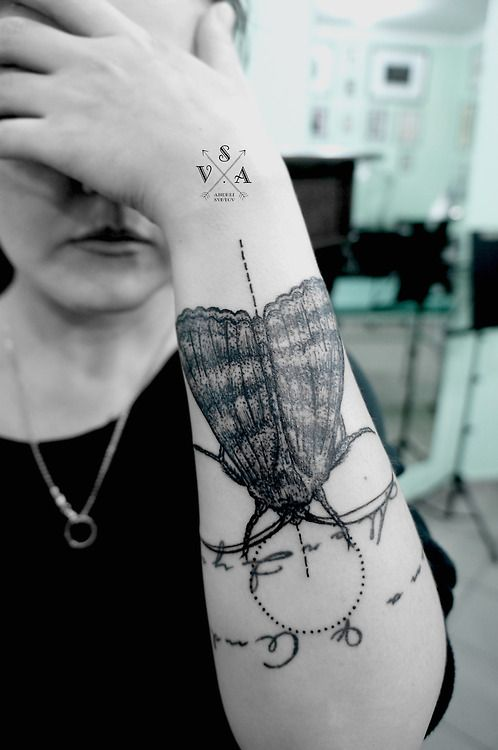 Fancy spool of thread tattoo