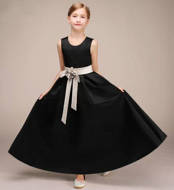 Elegant Black Satin Gown-Made To Order - High Quality Simple & Beautiful Round Neckline Sleeveless Ankle Length Infant Toddler Little & Big Girl Party Gown With Flower Sash Belt. Available from 7 -16 years. Material: Cotton & Satin. Color: Black. Please do compare your  little girl measurements with our size chart below or you may leave a note your little girl's height, bust and waist measurements so we can process it and send you the right size.