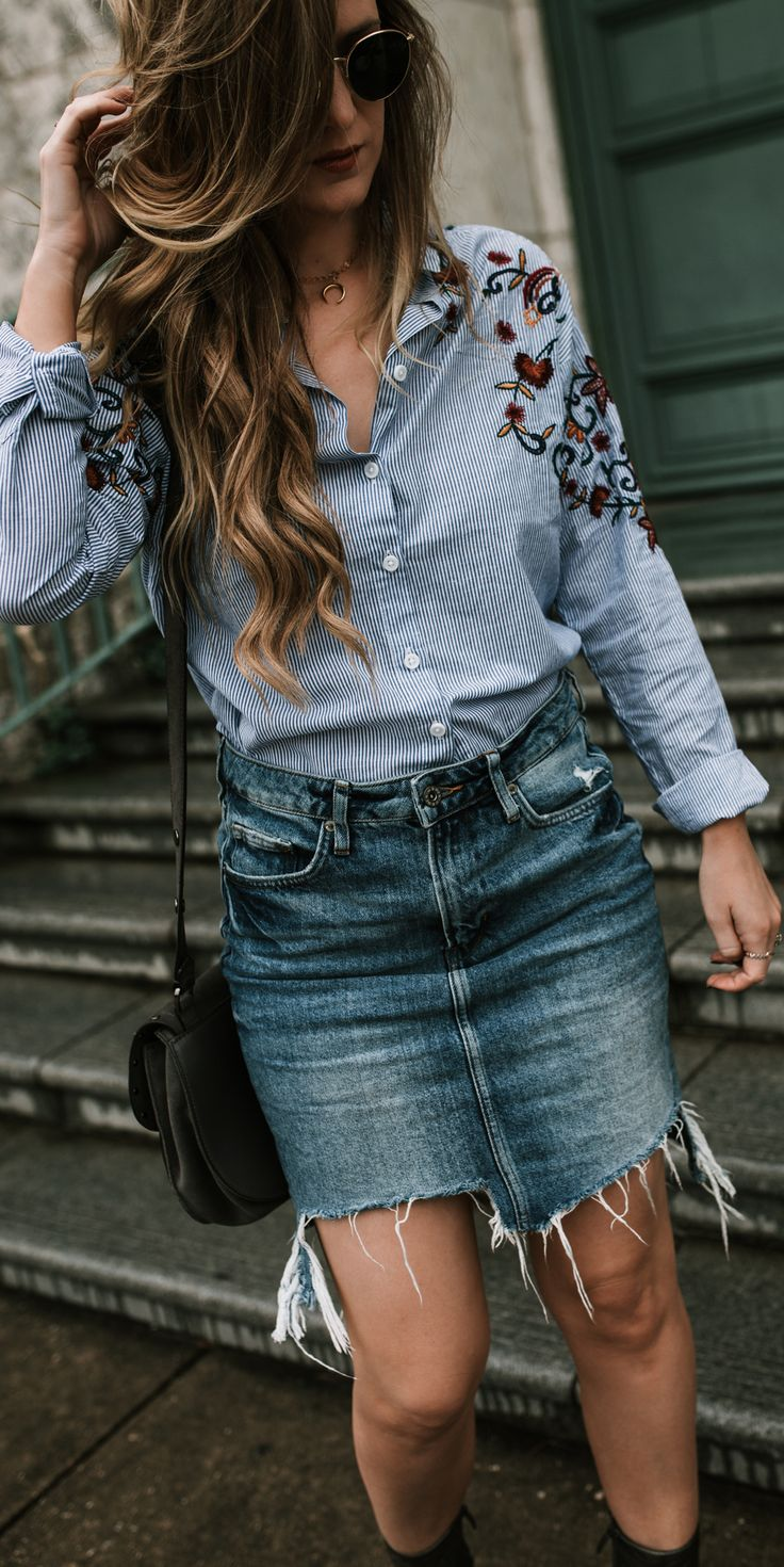 Edgy Fall outfit with embroidered shirt, distressed denim skirt, and metallic booties