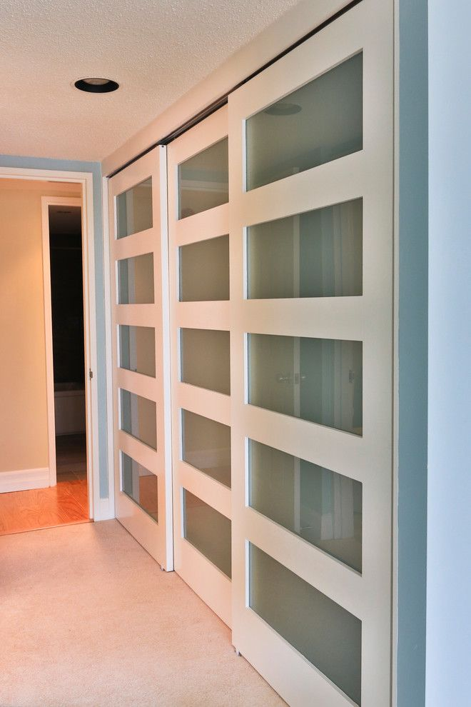 botanica white and glass sliding closet doors modernize this master bedroom closet closet ottawa dalton distinctive renovations