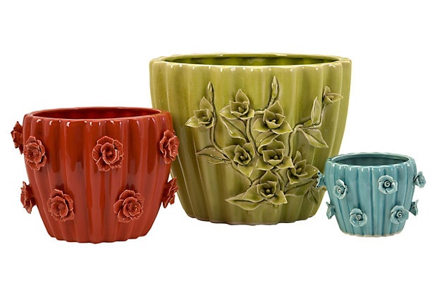 Cache pots. Love the green one jury is out on the other two.