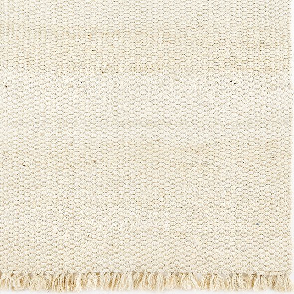 A bit dressier than traditional jutes, our Braided Jute Rug is extra thick and feels surprisingly soft, even on bare feet. Hand woven in thick braids of natural 100% jute and finished with a full, hand knotted 3 fringe. Braided Jute Rug features: Rug Pad recommendedAllow for 3/4 door clearanceSizes are approximateImported