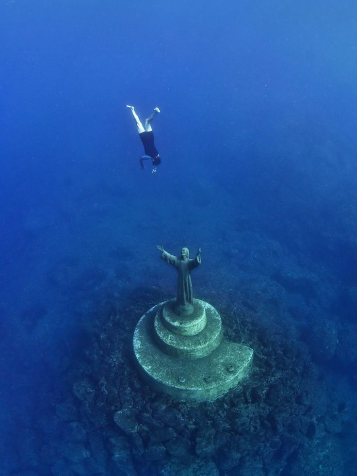 Christ of the Abyss, San Fruttuoso, Italy The eight-foot-tall Christ of the Abyss is located in the Mediterranean Sea off the coast of San Fruttuoso, where it has stood waiting for divers since the 1950s. With its outreached arms and upward gaze, it's hard to decide whether the statue is sublime or spooky. Regardless, it's worth taking a 55-foot dive down to snap an underwater selfie with Jesus. Photo: Alamy  via @AOL_Lifestyle Read more…
