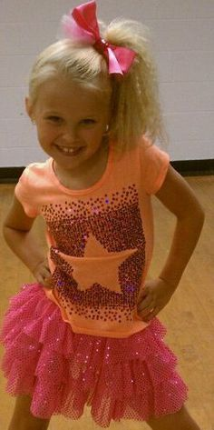 Jojo Siwa in the dressing room full costume and make up for the first group dance. Description from pinterest.com. I searched for this on bing.com/images