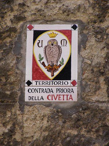 a tile sign in Siena for Contrada della Civetta
