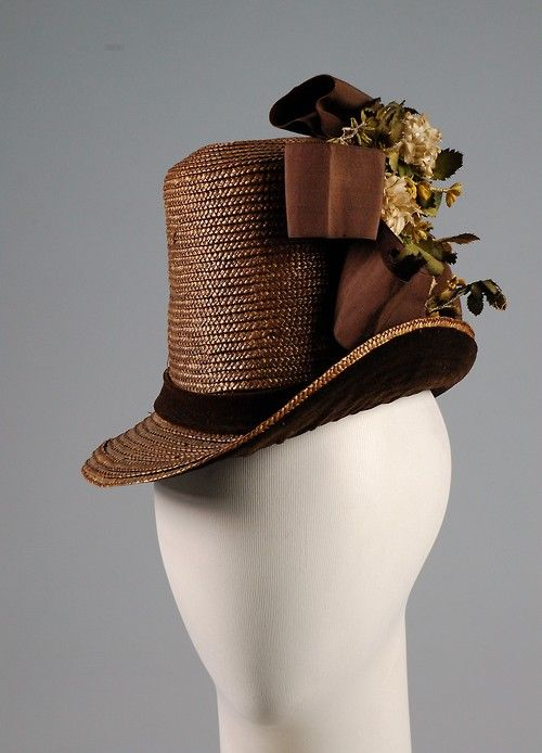 A lofty brown straw hat, 1884-86, from the Metropolitan Museum of Art. #Victorian #hat #fashion #1800s