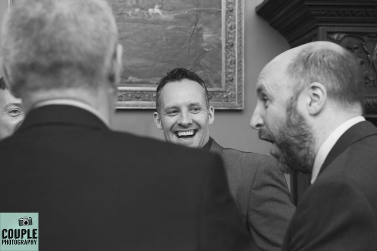Guests having a laugh at the wedding reception. Weddings at Kinnitty Castle photographed by Couple Photography.