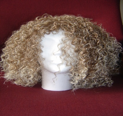 Funky Curl R270 SW001. Japanese Fibre Wigs.  Stunning quality.  Looks and feels like real hair!  Adjustable straps to suit head size.  BUFFY's WIGS (South Africa)  Cell 082 873 2706 buffycameron@gmail.com
