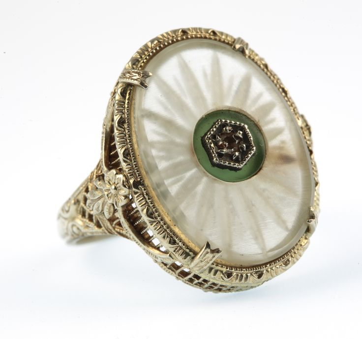 Lot 734, A 14ct white gold rock crystal and diamond set dress ring, size K 1/2, est  £100-150