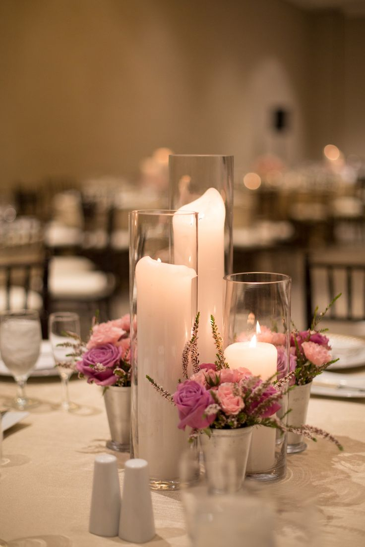 Siimple tall candle centerpieces with violet and pink small floral arrangements (Shay and Olive)