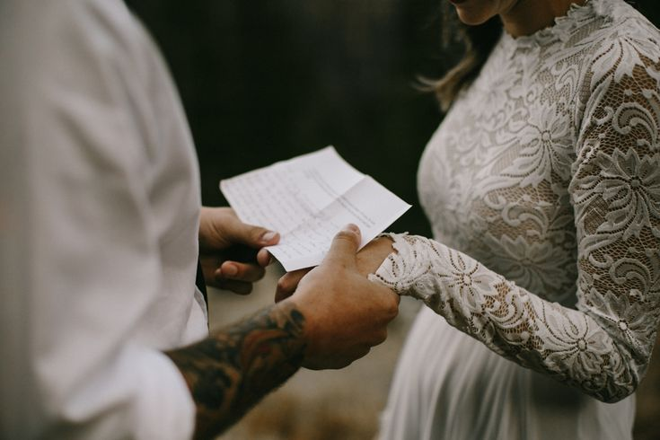 vow exchange from this elopement at Estes Park  Image by  From The Daisies