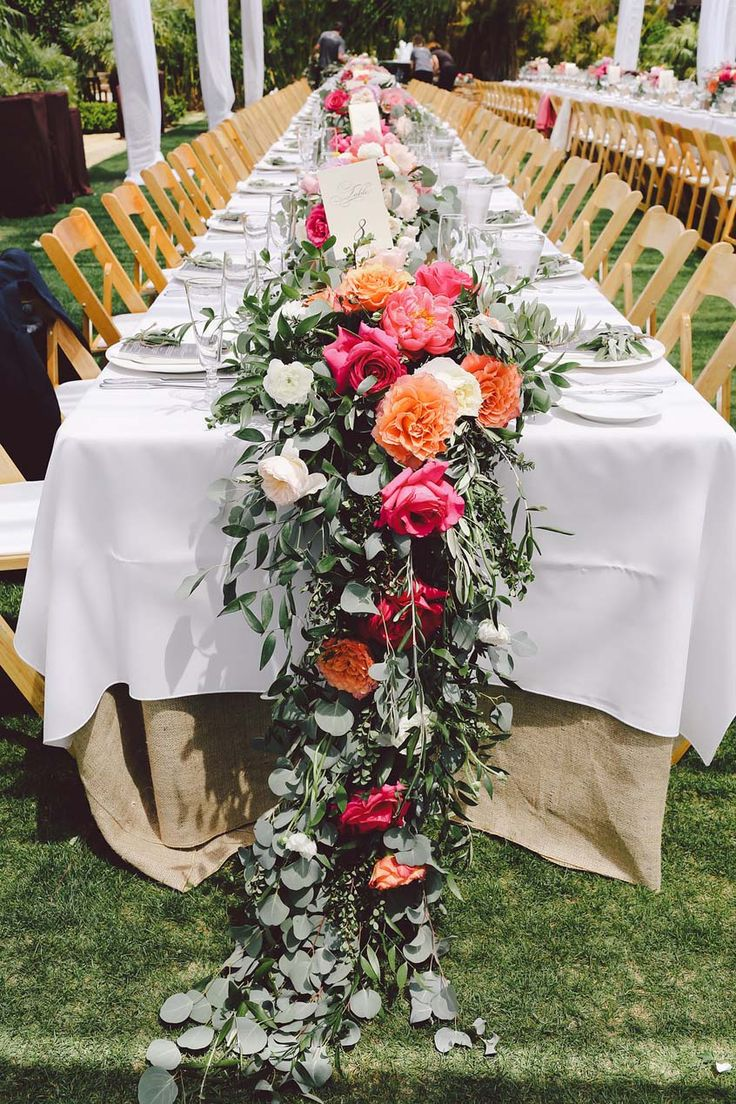 Flower table decorations - Wedding Floral Runner Featuring Roses And Eucalyptus Perfect For Long Wedding Tables At An Outdoor Summer Wedding