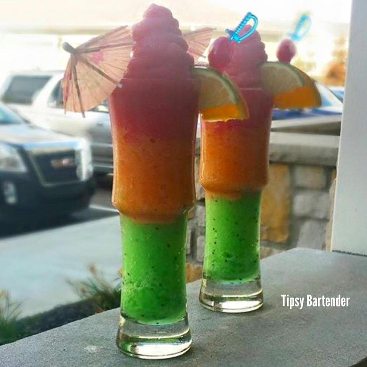 TROPICAL TWISTER  Blend Each Layer with 2 cups ice  Top Layer: Watermelon Mixer Triple Sec Tequila Agave  Lime Juice  Middle Layer Passion Fruit Mixer 99 Peach Vodka  Bacardi Dragonberry Rum  Lemon Juice  Bottom Layer: Pineapple Juice 2 Kiwis Pineapple Rum  Blue Curacao  Lime Juice