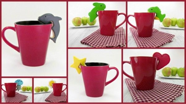 I have seen cookies that hang on cups before, but I LOVE the dolphin!!  SO CUTE!  thebearfootbaker.com