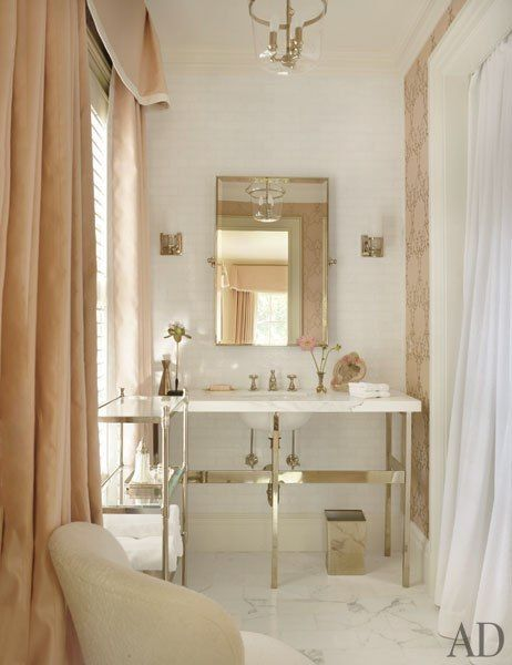 S. Kasler - A guest bath features an étagère and mirror by Restoration Hardware and sconces from Circa Lighting; the washstand, sink fittings, and tiles are by   http://amazinghomedesignsimages317.blogspot.com