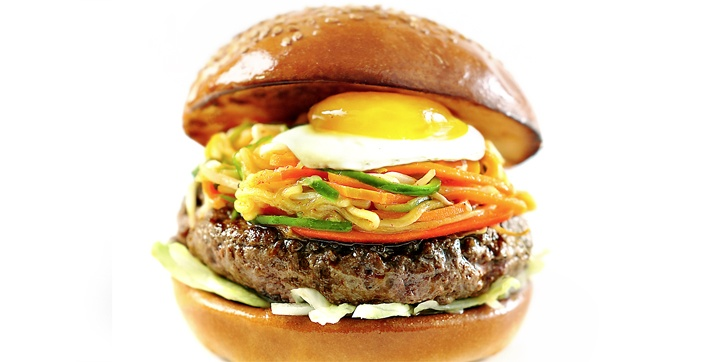 """★BIBIMBAP BURGER★  Korean for """"mixed meal"""", it's ground beef with a slow cooked egg, covered in lettuce and served with pickled carrot and cucumber."""