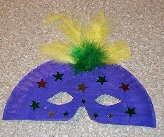 Mardi Gras mask made from paper plate and feathers- clever, cheap, cute and quick for the classroom.