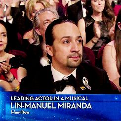 """Lin-Manuel Miranda giving """"the signal"""" from the episode """"What Kind Of Day Has It Been"""" of The West Wing"""