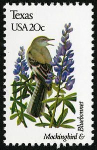A 1982 Texas stamp features a mockingbird and the bluebonnet