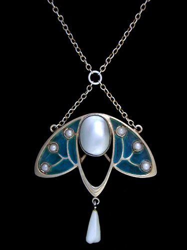 LEVINGER & BISSINGER   A gilded silver, plique-a-jour pendant. The central mother-of pearl, flanked with graduated blue plique-a-jour cells set with seed pearls and with a pearl drop.   German c.1900