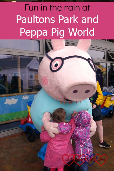 "Jessica and Sophie giving Daddy Pig a hug at Peppa Pig World - ""Fun in the rain at Paultons Park and Peppa Pig World"""