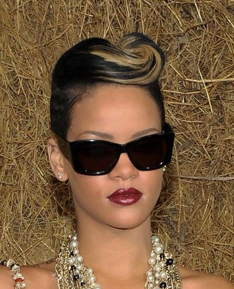 Pompadour hairstyleswere popularized during the 50s, but modern fashionistas have updated this poufy phenomenon in a number of avant-garde ways. Rihanna's hair is styled just so, with the perfect swirl to top off this pompadour-inspired cut.