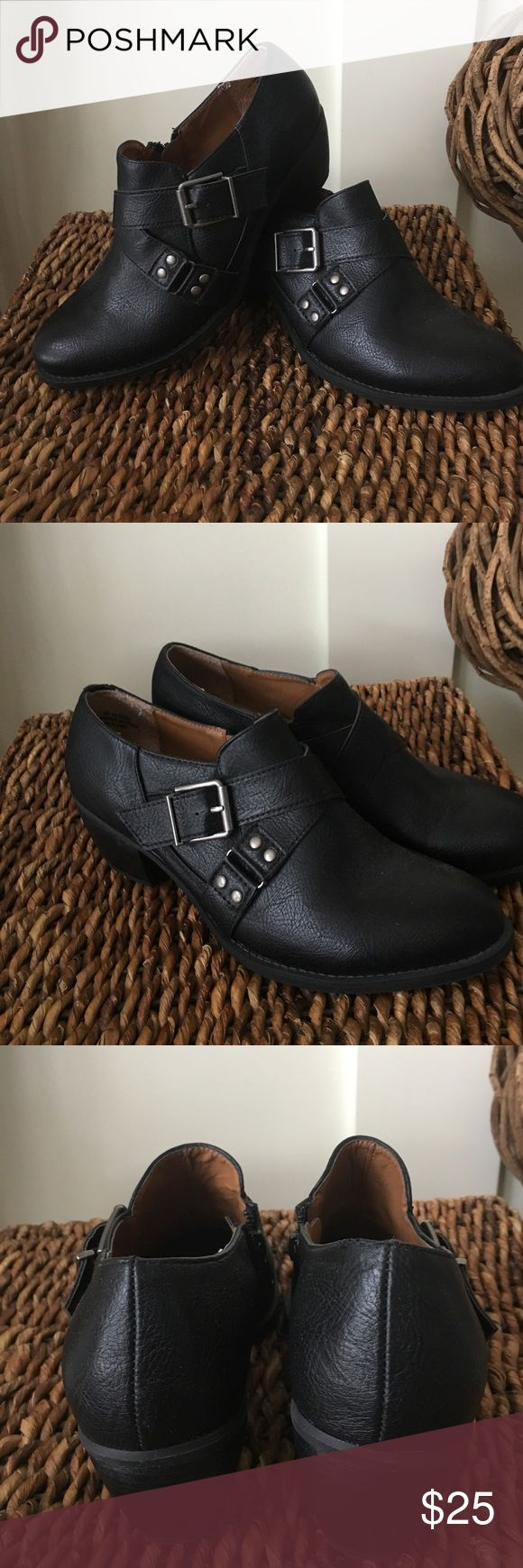 Relativity black slip on boot like new These cute black ankle boots are like new accented by crisscross band with Silvertone buckle approximate 2 inch heels for comfort Relativity Shoes Ankle Boots & Booties