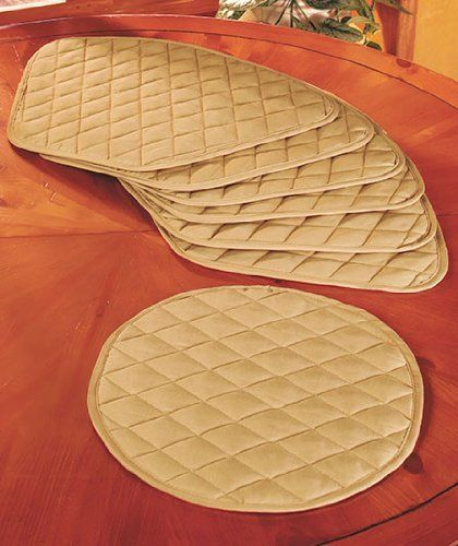 """Round Table Placemats (Set of 7) - Beige by LTI. $44.95. No more overlapping edges with these wedge placemats!. Polyester, Machine Care. Beige color - other colors available in separate listings. 6 Placemat wedges, 13-1/2"""" x 19-1/2"""". Round center mat, 13-3/4"""" dia.. This beige placemat set is perfect for round tables. The 6 placemats are shaped like wedges, and they will not take up extra space or hang over the edge of the table. This quilted set includes a roun..."""