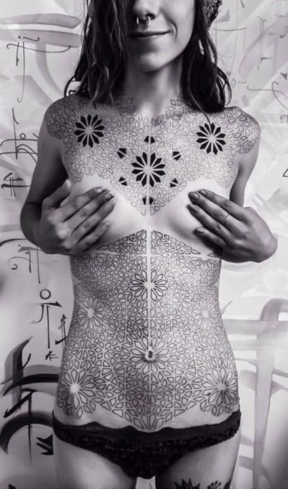 Geometric body suit tattoo