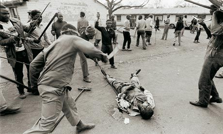 This shot is from photographer, Greg Marinovich, a South African who was covering the beginning of the anti-Apartheid movement in the country. Marinovich's photo, although brutal, illustrated what is actually happening in the hostiles throughout the country. The Apartheid government was hiding and covering up most of the issues and problems that were taking place throughout the poor black communities and photos like this helped expose what was really happening.