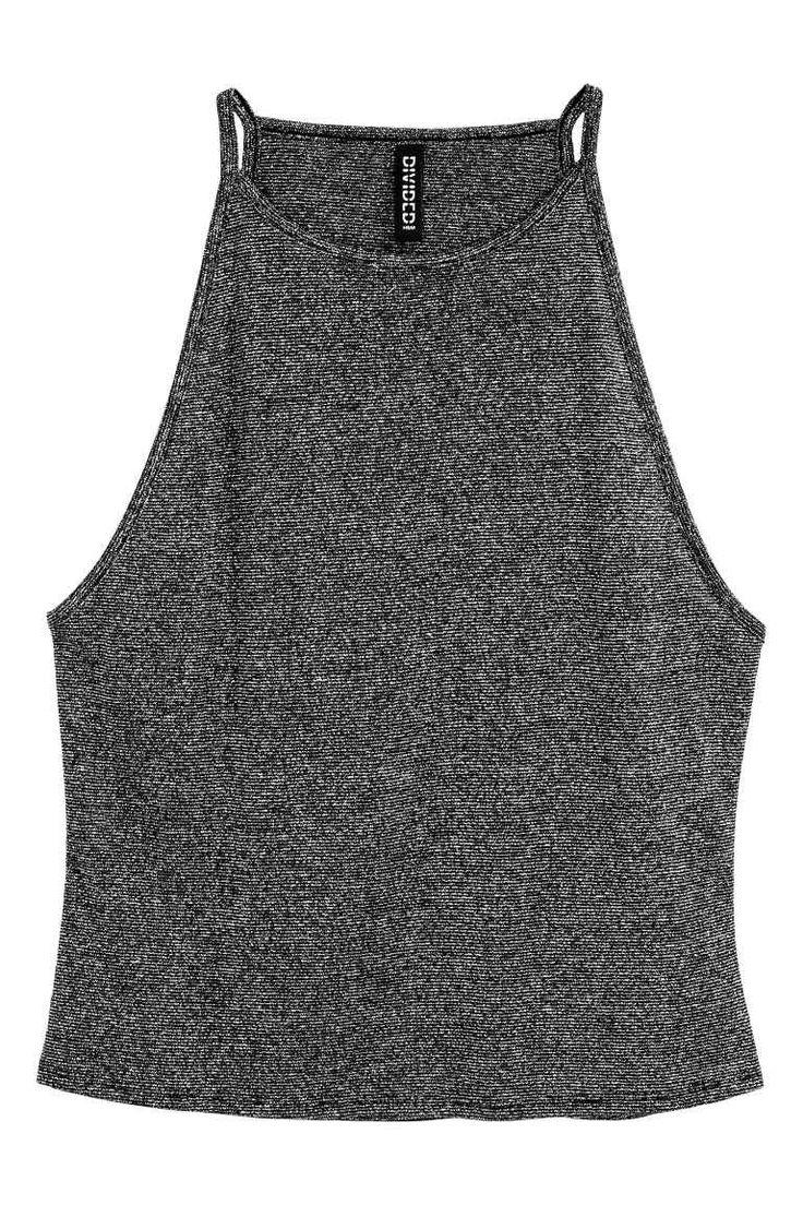 Canotta glitter: Canotta corta in jersey con fili glitter. Linea stretta in alto e spalline sottili.