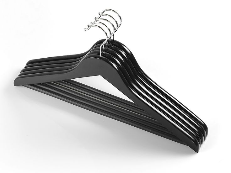Universal wooden hangers with plastic cover on bar. Size: 44,5cm.